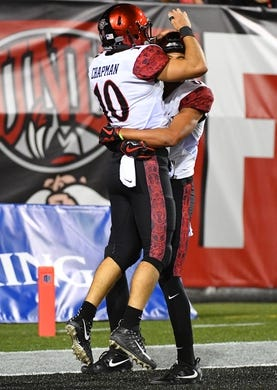 Oct 7, 2017; Las Vegas, NV, USA; San Diego Aztecs quarterback Christian Chapman (10) celebrates with wide receiver Mikah Holder (6) after rushing for a touchdown against the UNLV Rebels at Sam Boyd Stadium. Mandatory Credit: Stephen R. Sylvanie-USA TODAY Sports