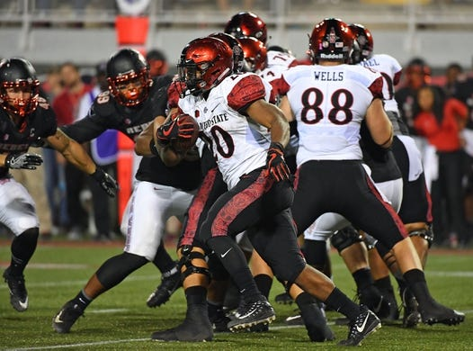 Oct 7, 2017; Las Vegas, NV, USA; San Diego State Aztecs running back Rashaad Penny (20) carries the ball during a game against the UNLV Rebels at Sam Boyd Stadium. Mandatory Credit: Stephen R. Sylvanie-USA TODAY Sports