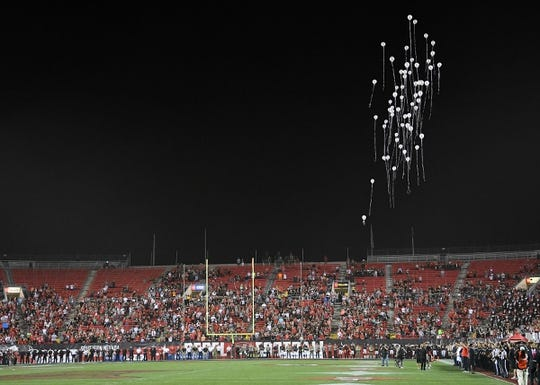 Oct 7, 2017; Las Vegas, NV, USA; Balloons representing each of the lives lost in the tragedy in Las Vegas are released by first responder personnel before the start of a game between the UNLV Rebels and the San Diego Aztecs at Sam Boyd Stadium. Mandatory Credit: Stephen R. Sylvanie-USA TODAY Sports