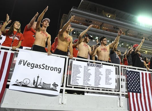 Oct 7, 2017; Las Vegas, NV, USA; UNLV Rebels fans in the student section cheer before a game between the UNLV Rebels and San Diego Aztecs at Sam Boyd Stadium. Mandatory Credit: Stephen R. Sylvanie-USA TODAY Sports