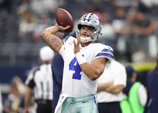 Oct 8, 2017; Arlington, TX, USA; Dallas Cowboys quarterback Dak Prescott (4) throws prior to the  game against the Green Bay Packers at AT&T Stadium. Mandatory Credit: Matthew Emmons-USA TODAY Sports