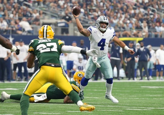 Oct 8, 2017; Arlington, TX, USA; Dallas Cowboys quarterback Dak Prescott (4) throws under pressure against the Green Bay Packers at AT&T Stadium. Mandatory Credit: Matthew Emmons-USA TODAY Sports
