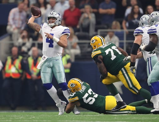 Oct 8, 2017; Arlington, TX, USA; Dallas Cowboys quarterback Dak Prescott (4) throws under pressure from Green Bay Packers linebacker Nick Perry (53) in the first quarter at AT&T Stadium. Mandatory Credit: Matthew Emmons-USA TODAY Sports
