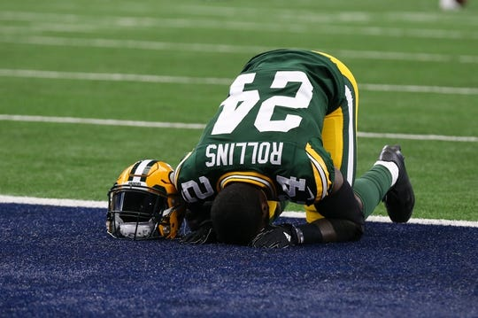 Oct 8, 2017; Arlington, TX, USA; Green Bay Packers cornerback Quinten Rollins (24) takes a moment and bws down in the end zone prior to the game against the Dallas Cowboys at AT&T Stadium. Mandatory Credit: Matthew Emmons-USA TODAY Sports