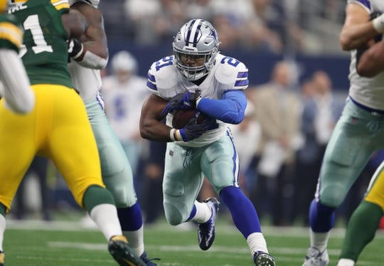 Oct 8, 2017; Arlington, TX, USA; Dallas Cowboys running back Ezekiel Elliott (21) runs with the ball against the Green Bay Packers at AT&T Stadium. Mandatory Credit: Matthew Emmons-USA TODAY Sports