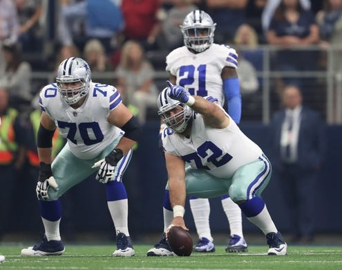 Oct 8, 2017; Arlington, TX, USA; Dallas Cowboys center Travis Frederick (72) signals prior to the snap with guard Zack Martin (70) against the Green Bay Packers at AT&T Stadium. Mandatory Credit: Matthew Emmons-USA TODAY Sports