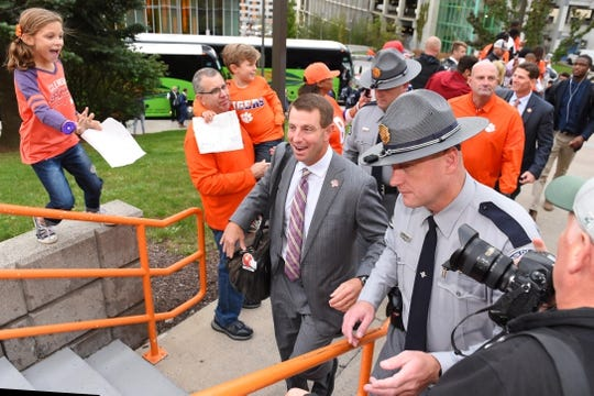 Oct 13, 2017; Syracuse, NY, USA; Clemson Tigers head coach Dabo Swinney walks to the Carrier Dome while being greeted by fans prior to the game against the Syracuse Orange. Mandatory Credit: Rich Barnes-USA TODAY Sports