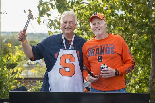 Oct 13, 2017; Syracuse, NY, USA; Syracuse fans grill up some sausage and burgers for their families as they enjoy their tailgate prior to the game between the Clemson Tigers and the Syracuse Orange at Carrier Dome. Mandatory Credit: Gregory J. Fisher-USA TODAY Sports