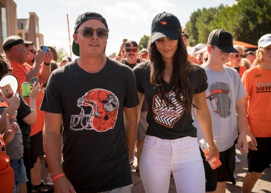 Oct 14, 2017; Stillwater, OK, USA; Rickie Fowler and girlfriend Allison Stokke prior to the game between the Baylor Bears and the Oklahoma State Cowboys at Boone Pickens Stadium. Mandatory Credit: Rob Ferguson-USA TODAY Sports