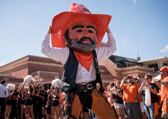 Oct 14, 2017; Stillwater, OK, USA; Oklahoma State Cowboys mascot Pistol Pete motions to the crowd during the walk prior to the game against the Baylor Bears at Boone Pickens Stadium. Mandatory Credit: Rob Ferguson-USA TODAY Sports