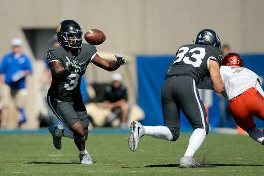 Oct 14, 2017; Colorado Springs, CO, USA; Air Force Falcons wide receiver Ronald Cleveland (3) bobbles the ball as running back Tim McVey (33) defends against UNLV Rebels defensive back Jericho Flowers (7) in the first quarter at Falcon Stadium. Mandatory Credit: Isaiah J. Downing-USA TODAY Sports