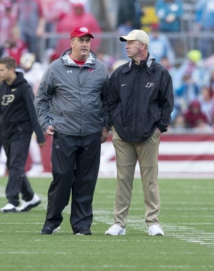 Oct 14, 2017; Madison, WI, USA; Wisconsin Badgers head coach Paul Chryst talks with Purdue Boilermakers head coach Jeff Brohm prior to the game at Camp Randall Stadium. Mandatory Credit: Jeff Hanisch-USA TODAY Sports