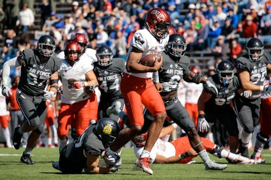Oct 14, 2017; Colorado Springs, CO, USA; UNLV Rebels quarterback Armani Rogers (1) is tied up by Air Force Falcons defensive back Jeremy Fejedelem (27) as linebacker Shaquille Vereen (6) defends in the second quarter at Falcon Stadium. Mandatory Credit: Isaiah J. Downing-USA TODAY Sports