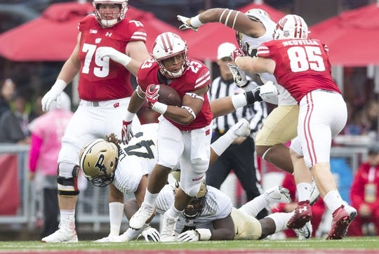 Oct 14, 2017; Madison, WI, USA; Wisconsin Badgers running back Jonathan Taylor (23) rushes with the football during the first quarter against the Purdue Boilermakers at Camp Randall Stadium. Mandatory Credit: Jeff Hanisch-USA TODAY Sports