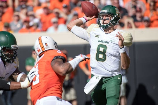 Oct 14, 2017; Stillwater, OK, USA; Baylor Bears quarterback Zach Smith (8) passes against the Oklahoma State Cowboys during the first quarter at Boone Pickens Stadium. Mandatory Credit: Rob Ferguson-USA TODAY Sports