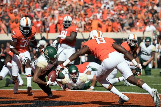 Oct 14, 2017; Stillwater, OK, USA; Baylor Bears running back Trestan Ebner (25) recovers a fumble for a touchdown against the Oklahoma State Cowboys during the first quarter at Boone Pickens Stadium. Mandatory Credit: Rob Ferguson-USA TODAY Sports