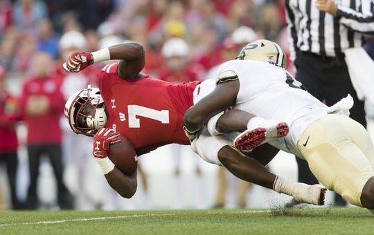 Oct 14, 2017; Madison, WI, USA; Wisconsin Badgers running back Bradrick Shaw (7) is tackled with the football during the second quarter against the Purdue Boilermakers at Camp Randall Stadium. Mandatory Credit: Jeff Hanisch-USA TODAY Sports