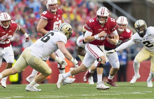 Oct 14, 2017; Madison, WI, USA; Wisconsin Badgers quarterback Alex Hornibrook (12) rushes with the football during the second quarter against the Purdue Boilermakers at Camp Randall Stadium. Mandatory Credit: Jeff Hanisch-USA TODAY Sports