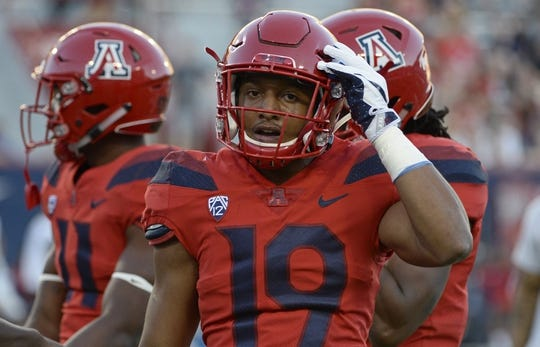 Oct 14, 2017; Tucson, AZ, USA; Arizona Wildcats safety Scottie Young Jr. (19) warms up before the game against the UCLA Bruins at Arizona Stadium. Mandatory Credit: Casey Sapio-USA TODAY Sports
