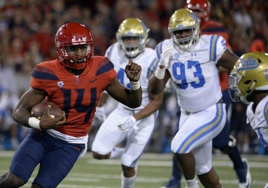 Oct 14, 2017; Tucson, AZ, USA; Arizona Wildcats quarterback Khalil Tate (14) runs the ball against the UCLA Bruins during the second half at Arizona Stadium. Mandatory Credit: Casey Sapio-USA TODAY Sports