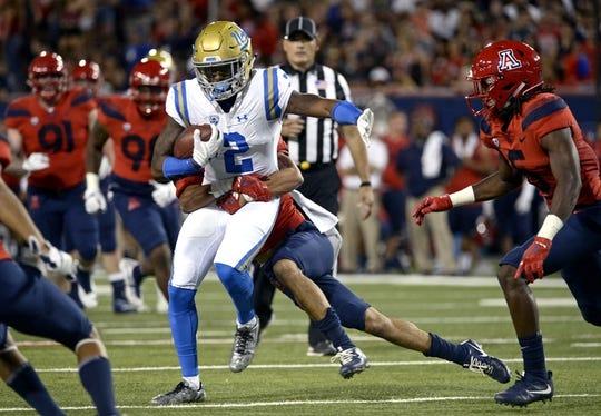 Oct 14, 2017; Tucson, AZ, USA; UCLA Bruins wide receiver Jordan Lasley (2) is tackled by Arizona Wildcats cornerback Lorenzo Burns (2) during the first half at Arizona Stadium. Mandatory Credit: Casey Sapio-USA TODAY Sports
