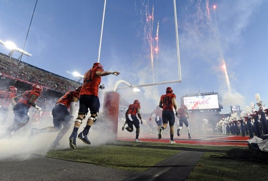 Oct 14, 2017; Tucson, AZ, USA; The Arizona Wildcats run on to the field before the game against the UCLA Bruins at Arizona Stadium. Mandatory Credit: Casey Sapio-USA TODAY Sports
