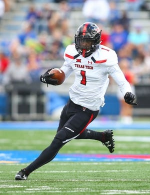 Oct 7, 2017; Lawrence, KS, USA; Texas Tech Red Raiders wide receiver Quan Shorts (1) runs against the Kansas Jayhawks in the first half at Memorial Stadium. Mandatory Credit: Jay Biggerstaff-USA TODAY Sports