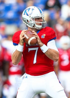 Oct 7, 2017; Lawrence, KS, USA; Kansas Jayhawks quarterback Peyton Bender (7) drops back to pass against the Texas Tech Red Raiders in the first half at Memorial Stadium. Mandatory Credit: Jay Biggerstaff-USA TODAY Sports