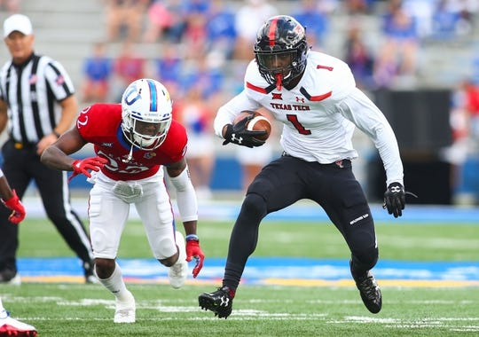 Oct 7, 2017; Lawrence, KS, USA; Texas Tech Red Raiders wide receiver Quan Shorts (1) runs against Kansas Jayhawks safety Tyrone Miller Jr. (22) in the first half at Memorial Stadium. Mandatory Credit: Jay Biggerstaff-USA TODAY Sports