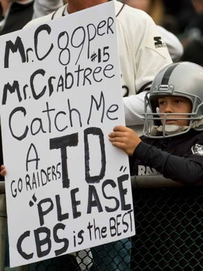 Oct 19, 2017; Oakland, CA, USA; A young Oakland Raiders fan hold a sign from the stands prior to the game against the Kansas City Chiefs at Oakland Coliseum. Mandatory Credit: Kelley L Cox-USA TODAY Sports