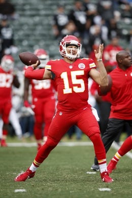 Oct 19, 2017; Oakland, CA, USA; Kansas City Chiefs quarterback Patrick Mahomes (15) throws a pass prior to the game against the Oakland Raiders at Oakland Coliseum. Mandatory Credit: Cary Edmondson-USA TODAY Sports