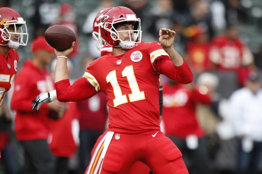 Oct 19, 2017; Oakland, CA, USA; Kansas City Chiefs quarterback Alex Smith (11) throws a pass prior to the game against the Oakland Raiders at Oakland Coliseum. Mandatory Credit: Cary Edmondson-USA TODAY Sports