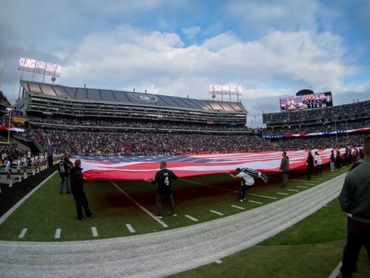 Oct 19, 2017; Oakland, CA, USA; A large American flag on the field for the national anthem prior to the game between the Oakland Raiders and the Kansas City Chiefs at Oakland Coliseum. Mandatory Credit: Kelley L Cox-USA TODAY Sports