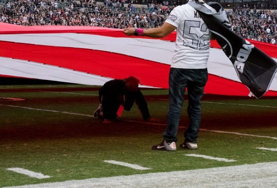 Oct 19, 2017; Oakland, CA, USA; A person walks out from under the flag before the game between the Oakland Raiders and the Kansas City Chiefs at Oakland Coliseum. Mandatory Credit: Kelley L Cox-USA TODAY Sports