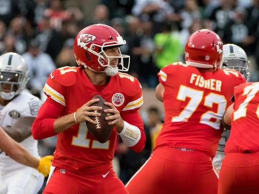 Oct 19, 2017; Oakland, CA, USA; Kansas City Chiefs quarterback Alex Smith (11) prepares to throw the ball against the Oakland Raiders during the first quarter at Oakland Coliseum. Mandatory Credit: Kelley L Cox-USA TODAY Sports