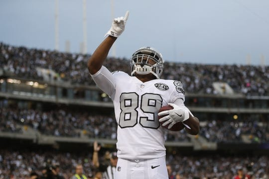 Oct 19, 2017; Oakland, CA, USA; Oakland Raiders wide receiver Amari Cooper (89) celebrates after catching a touchdown pass against the Kansas City Chiefs in the first quarter at Oakland Coliseum. Mandatory Credit: Cary Edmondson-USA TODAY Sports