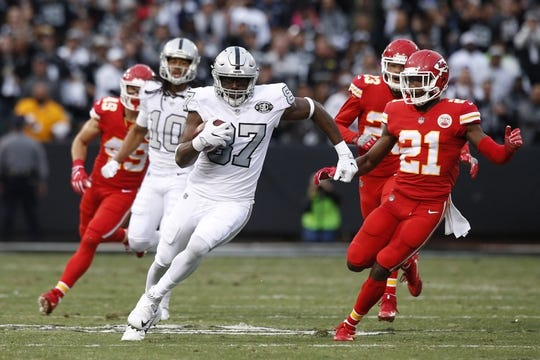 Oct 19, 2017; Oakland, CA, USA; Oakland Raiders tight end Jared Cook (87) carries the ball against the Kansas City Chiefs in the first quarter at Oakland Coliseum. Mandatory Credit: Cary Edmondson-USA TODAY Sports