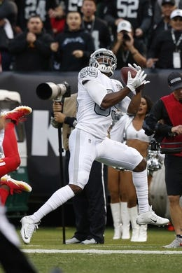 Oct 19, 2017; Oakland, CA, USA; Oakland Raiders wide receiver Amari Cooper (89) catches a touchdown pass against the Kansas City Chiefs in the first quarter at Oakland Coliseum. Mandatory Credit: Cary Edmondson-USA TODAY Sports