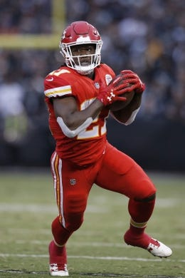Oct 19, 2017; Oakland, CA, USA; Kansas City Chiefs running back Kareem Hunt (27) runs with the ball after making a catch against the Oakland Raiders in the first quarter at Oakland Coliseum. Mandatory Credit: Cary Edmondson-USA TODAY Sports