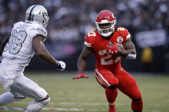 Oct 19, 2017; Oakland, CA, USA; Kansas City Chiefs running back Kareem Hunt (27) carries the ball against the Oakland Raiders in the first quarter at Oakland Coliseum. Mandatory Credit: Cary Edmondson-USA TODAY Sports