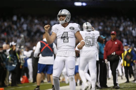 Oct 19, 2017; Oakland, CA, USA; Oakland Raiders quarterback Derek Carr (4) reacts after throwing a touchdown pass against the Kansas City Chiefs in the first quarter at Oakland Coliseum. Mandatory Credit: Cary Edmondson-USA TODAY Sports