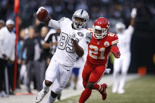 Oct 19, 2017; Oakland, CA, USA; Oakland Raiders wide receiver Amari Cooper (89) scores a touchdown against the Kansas City Chiefs in the first quarter at Oakland Coliseum. Mandatory Credit: Cary Edmondson-USA TODAY Sports