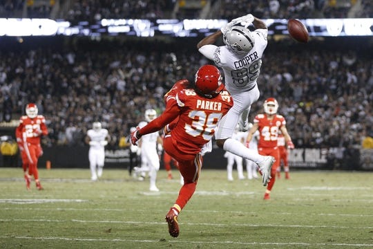 Oct 19, 2017; Oakland, CA, USA; Oakland Raiders wide receiver Amari Cooper (89) is unable to make a catch in front of Kansas City Chiefs free safety Ron Parker (38) in the second quarter at Oakland Coliseum. Mandatory Credit: Cary Edmondson-USA TODAY Sports