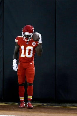 Oct 19, 2017; Oakland, CA, USA; Kansas City Chiefs wide receiver Tyreek Hill (10) reacts after catching a touchdown pass against the Oakland Raiders in the second quarter at Oakland Coliseum. Mandatory Credit: Cary Edmondson-USA TODAY Sports