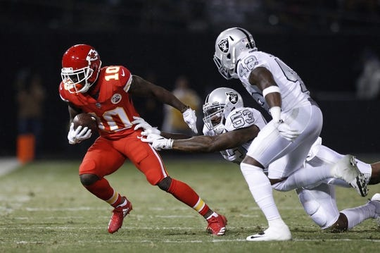 Oct 19, 2017; Oakland, CA, USA; Oakland Raiders linebacker NaVorro Bowman (53) attempts to tackle Kansas City Chiefs wide receiver Tyreek Hill (10) in the second quarter at Oakland Coliseum. Mandatory Credit: Cary Edmondson-USA TODAY Sports