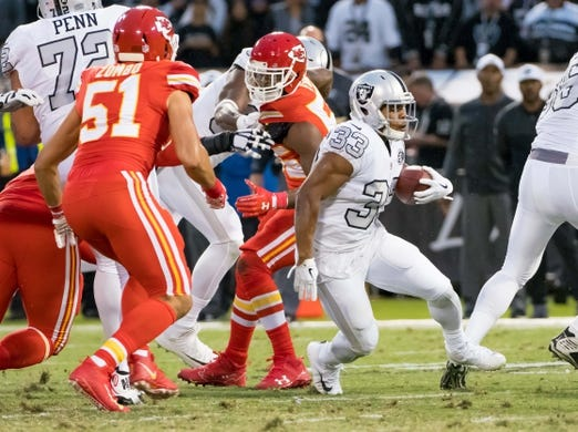 Oct 19, 2017; Oakland, CA, USA; Oakland Raiders running back DeAndre Washington (33) carries the ball against the Kansas City Chiefs during the second quarter at Oakland Coliseum. Mandatory Credit: Kelley L Cox-USA TODAY Sports