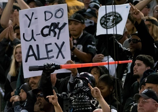Oct 19, 2017; Oakland, CA, USA; Oakland Raiders fans with a sign for Kansas City Chiefs quarterback Alex Smith (not pictured) during the second quarter at Oakland Coliseum. Mandatory Credit: Kelley L Cox-USA TODAY Sports