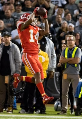 Oct 19, 2017; Oakland, CA, USA; Kansas City Chiefs wide receiver Demarcus Robinson (14) catches the ball against the Oakland Raiders during the second quarter at Oakland Coliseum. Mandatory Credit: Kelley L Cox-USA TODAY Sports
