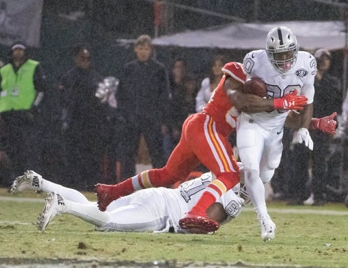 Oct 19, 2017; Oakland, CA, USA; Oakland Raiders running back Jalen Richard (30) carries the ball against the Kansas City Chiefs during the second quarter at Oakland Coliseum. Mandatory Credit: Kelley L Cox-USA TODAY Sports