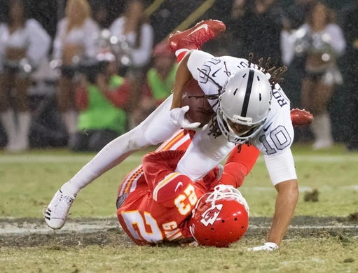 Oct 19, 2017; Oakland, CA, USA; Oakland Raiders wide receiver Seth Roberts (10) is brought down by Kansas City Chiefs cornerback Phillip Gaines (23) during the second quarter at Oakland Coliseum. Mandatory Credit: Kelley L Cox-USA TODAY Sports